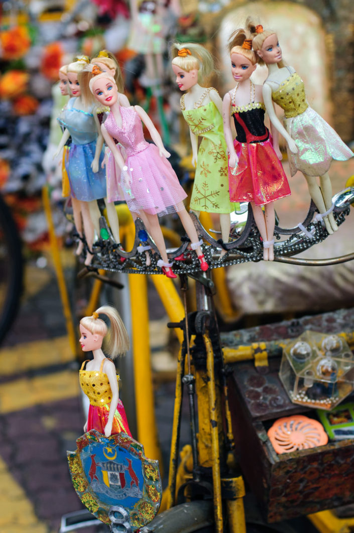 A rickshaw in Malacca, Malaysia is decorated with barbie dolls